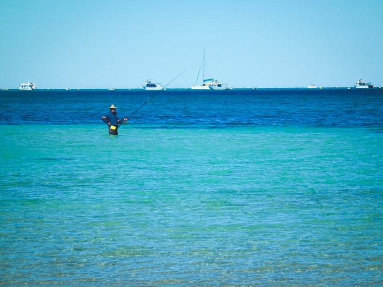 Pêcheur à Coral Bay